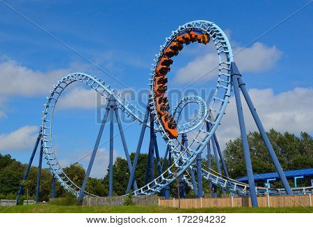 CORTON, SUFFOLK, ENGLAND - AUGUST 16, 2016: Roller coaster  ride filled  with thrill seekers