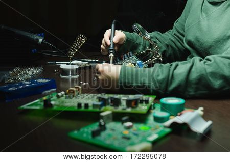 Repair of electronic devices tin soldering parts. solderer