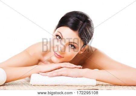 Beautiful, young and healthy woman in spa salon. Isolated on white. Spa, health and healing concept.