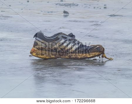 The dirty Sneakers froze on the ice