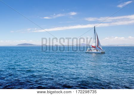 View of sailing boat on Atlantic Ocean near Robben Island South African coast