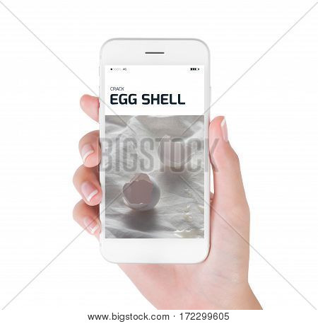 Woman using her smart phone searching crack egg shell in still life photography Food and drink concept isolated on white background.
