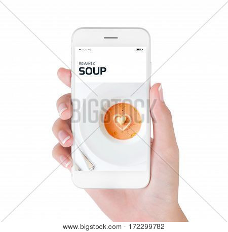 Woman using her smart phone for searching Romantic soup and heart symbol Food and drink concept isolated on white background.
