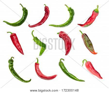 Top view of the several red and green peppers chili with a various shapes of pods are laid out in three rows on a light background