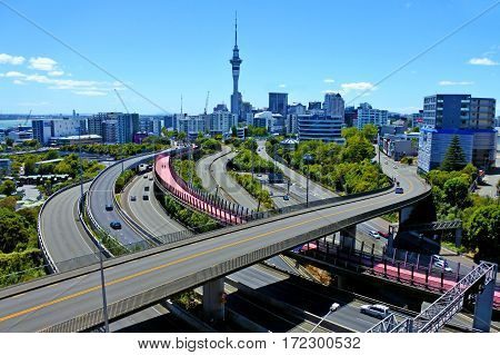 AUCKLAND - FEB 11 2017: Urban aerial landscape view of traffic on Auckland city motorway. It is the most populous urban area in New Zealand.