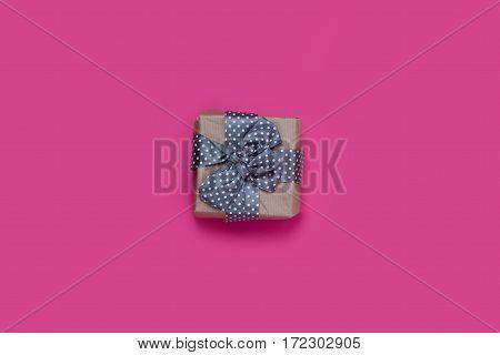 beautiful blue gift lying on the wonderful pink background
