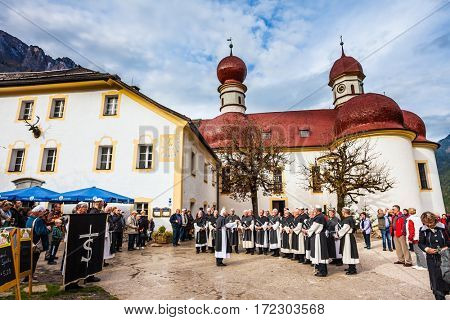 KONIGSSEE, BAVARIA, GERMANY - OCTOBER 4, 2013: Monastic Choir performs ritual chants. Church of St. Bartholomew at Lake Königssee. Catholic chapel in Baroque style