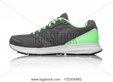 Unbranded modern sneaker isolated on a white background. Lime or green sneakers.