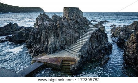 Detailed view of volcanic rocks, castle shape in the ocean, terceira, azores islands
