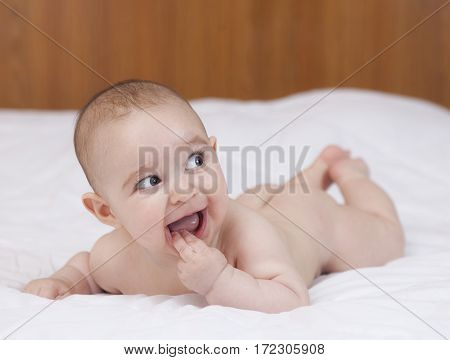 Beautiful Cute Teething Baby Biting Fingers With Funny Expression