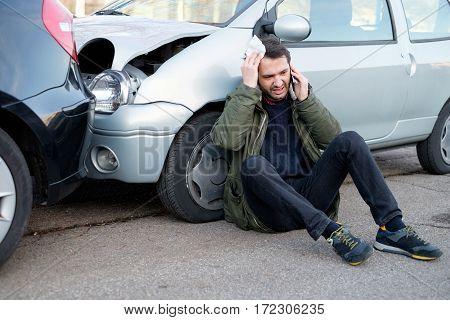 Man Calling First Aid After Car Crash