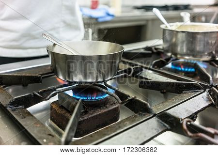 Dish on gas stove in restaurant or hotel kitchen