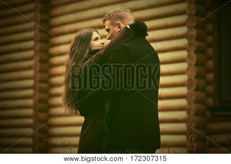 Happy young couple in love embracing. Stylish fashion model outdoor