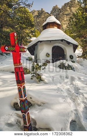 Chapel and red cross at symbolic cemetery in High tatras mountains Slovakia
