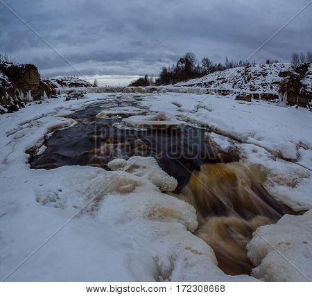Waterfall in winter Tosnenskiy, Leningrad oblast, Russia