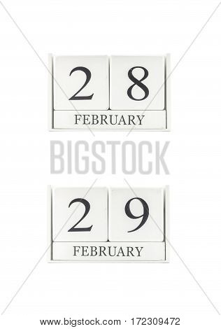 Closeup group of white wooden calendar with black 28 29 february word three date calendar isolated on white background
