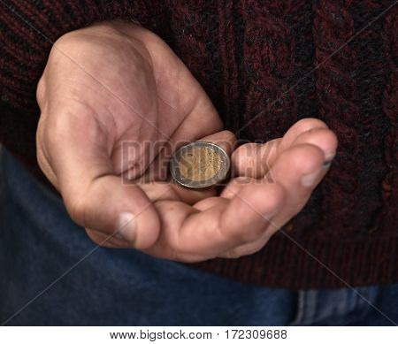Old Man Holding Pile Of Coins