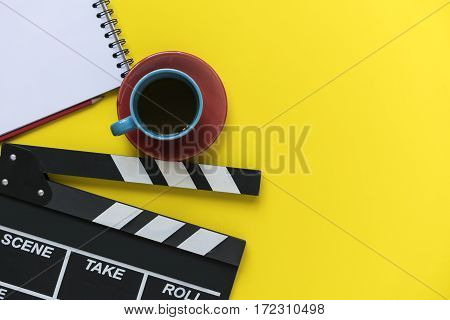movie clapper on yellow background, top view