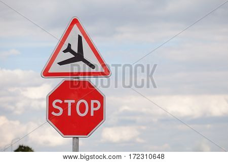 Two road signs on the sky background