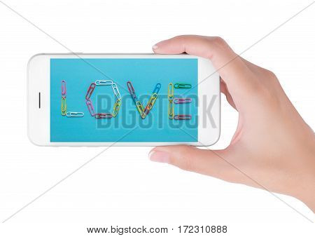 Woman using smart phone searching colorful paper clips forming the word