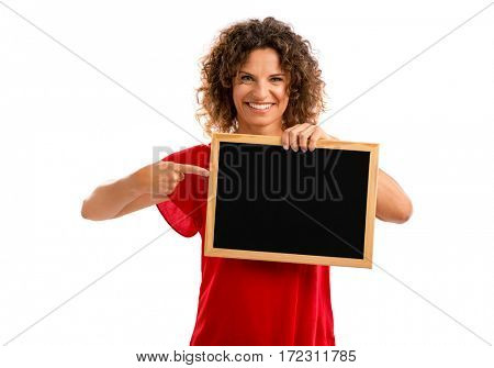 Portrait of a smiling middle aged brunette holding a chalkboard