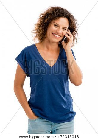 Beautiful young woman with mobile phone making a phone call