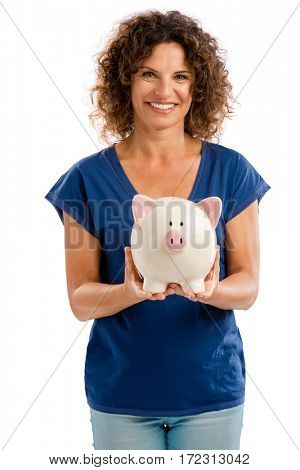 Portrait of a happy middle aged woman holding a Piggybank