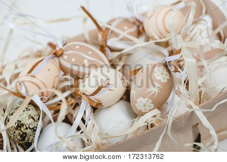 Close-up view of decorative painted easter eggs in box