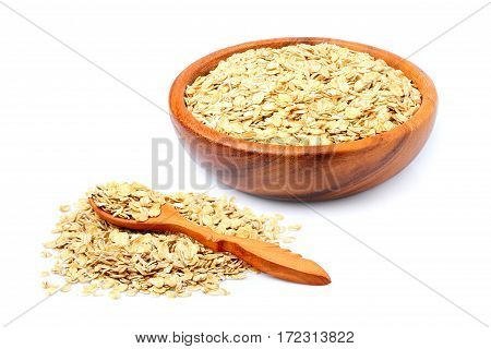 Oat flakes in a wooden bowl and wooden spoon isolated on white background.