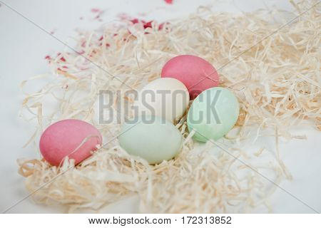 Close-up view of beautiful painted easter eggs and decorative shavings