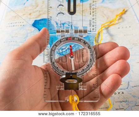 compass in hand. travel background or texture