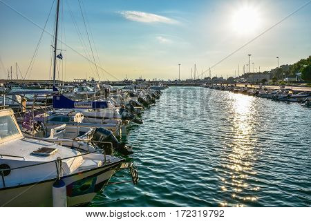 ROCCELLA IONICA, ITALY - September 30, 2016: Port of Roccella Ionica in the evening with fishing boats and luxury yachts. Port of Ionian Sea, Calabria, south Italy.
