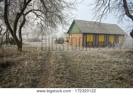 Abandoned country house in winter. Wood farmhouse