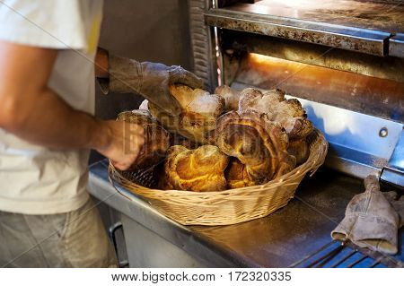 Taking Bread Out Of Oven