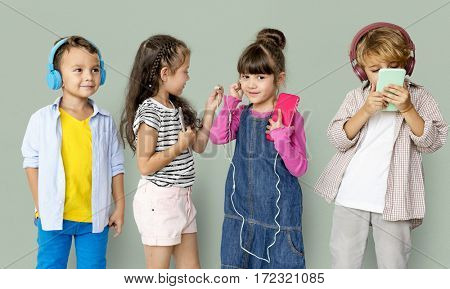 Happiness group of cute and adorable children listening music