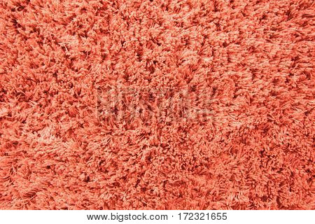 Light orange wool carpet cloth texture for design and background. Floor and home decoration.