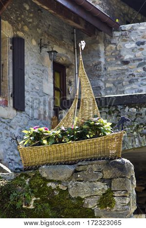 Braided ship as a flowerbed in old town