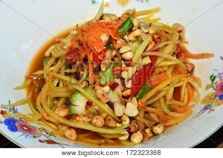 Green Papaya Salad (som tam) is a popular dish from Thailand that combines spicy sour and sweet flavors to make a classic dish. It is often served alongside barbecue or grilled chicken