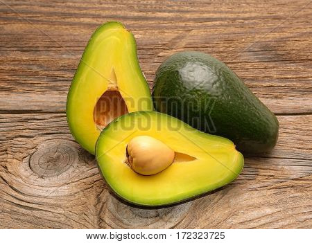 Avocado isolated on wooden background in studio