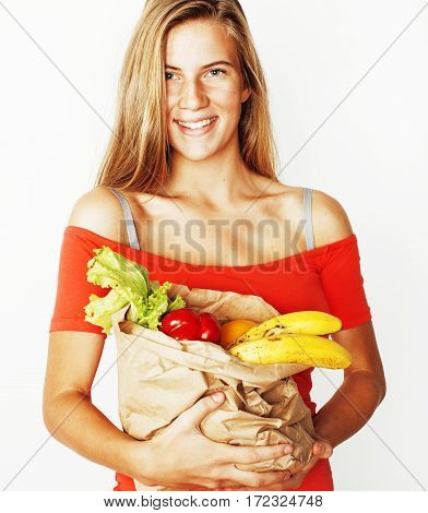 young pretty blond woman at shopping with food in paper bag isolated on white smiling bright, lifestyle real modern people concept close up