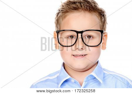 Portrait of a big confident smart boy wearing classic shirt and glasses. School uniform. Education. Copy space. Isolated over white background.