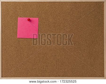 Pink Blank sticky notes red pinned into brown corkboard