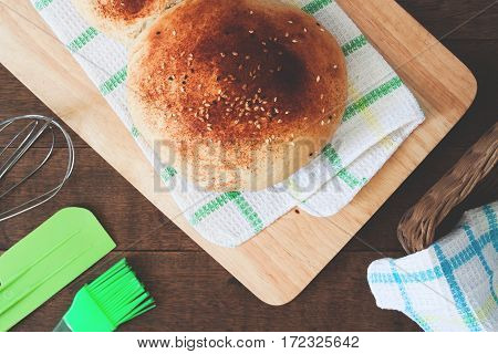 loaf of bread on wood background with bakery tools flat lay food closeup