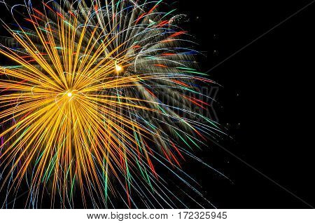 A golden firework shot off in the night sky