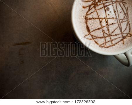 One mug of hot chocolate from a tabletop perspective on a granite surface.
