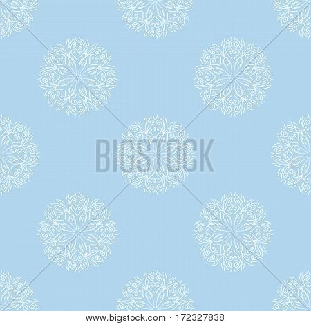 White floral motif on pale blue background. Repeating pattern ornament. Seamless background for webpages. Vector