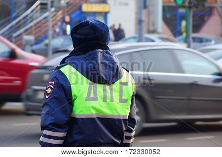 MOSCOW, RUSSIA-November 2014.  Officer patrol service watching road traffic.