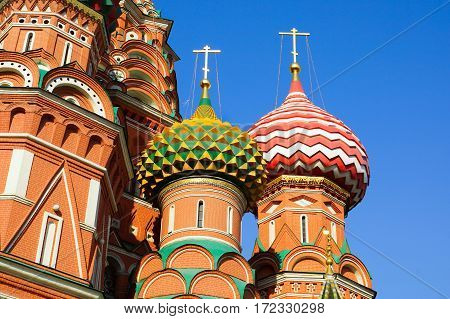 Two domes of the temple St. Basil's Cathedral. Against the blue sky. Moscow