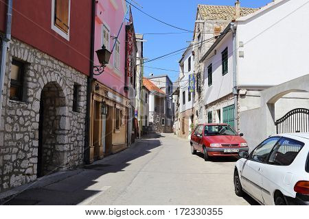 VODICE, CROATIA - SEPTEMBER 6, 2016: This is one of the streets of modern Croatian architecture which is typical for small coastal towns.