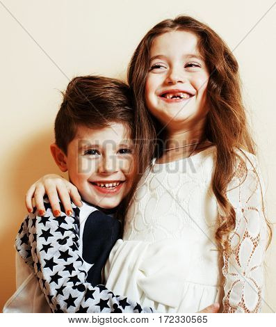 little cute boy and girl hugging playing on white background, happy family smiling close up